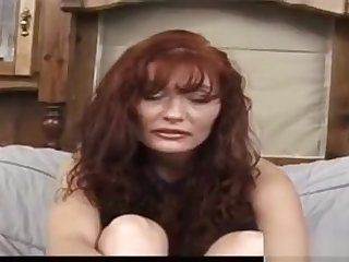Esther Fine Has Long Red Hair And A Massive Pair Of...