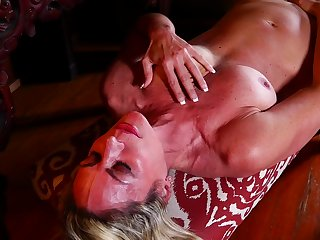Blonde mature amateur MILF Sydney strips and oils up her body