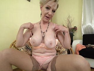 Amateur mature blonde short haired MILF Maris masturbates at home