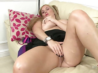 Naughty Milf rubs her clit and plays with her giant boobs!
