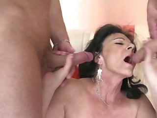 Granny with thirsty vagina takes two young cocks