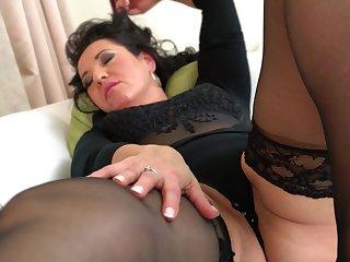 BBW brunette mature amateur Isadora M. caresses her shaved pussy