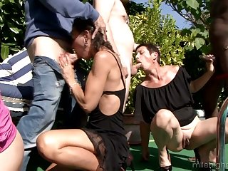 Several horny dudes fuck Zaza La Coquine and her girlfriends by the poolside