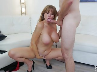 Dick and ball sucking milf with a nice set of big titties