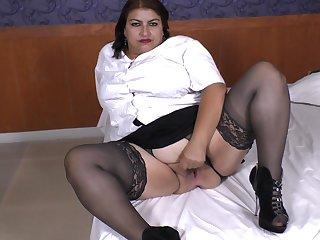 Buxom amateur mature brunette Latina granny Carmen O. spreads pussy