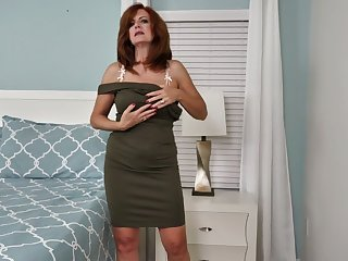 Andi James is awesome mature busty lady who loves working on her wet pussy