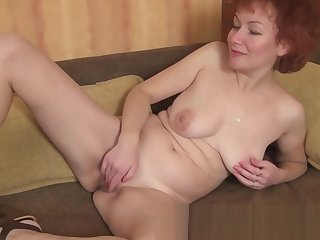 Julia fingers her mature cougar vagina