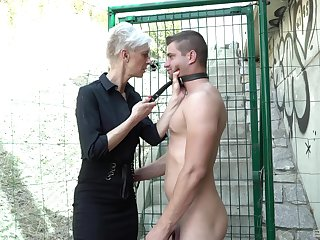Mature Martina and her kinky friend adore the humiliation outside