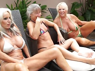Mature grannies share BBC in outdoor interracial threesome by the pool