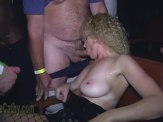 Curly granny sucks cocks of crowd of younger guys