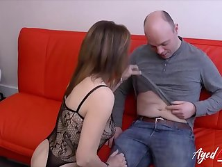 Mature lady massaging his hard dick with her tongue and lips