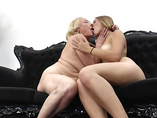 Mature blonde lesbian teaches a younger girl how to use her tongue