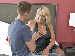 Mature blonde slut Bianca J. in stockings teaching a younger guy