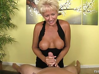 Blonde mature teases with her boobs and pussy during a dick massage