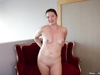 Short haired brunette wife strips and drops on her knees for a handjob