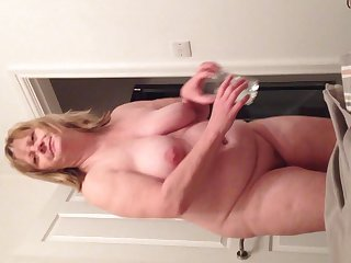 Hot bbw wife removes clothes to reveal 40 inch breasts and large belly