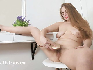 Bossaia Golloia strips naked in front of her mirror