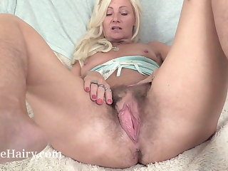 Mature British masturbates with her toy