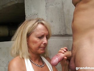 Dirty granny drops on her knees to give head and rides like a pro