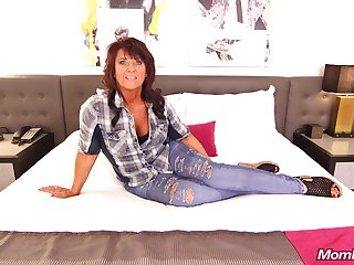Mature woman with big boobs is holding her legs spread wide and getting fucked quite hard