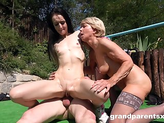 Old guy sticks his dick in his wife's pussy and fucks a younger girl