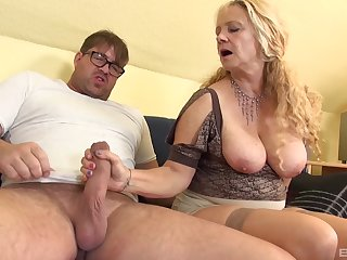 Busty blonde mature takes a long dick in her loose asshole