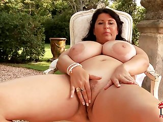 Natalie Fiore - confident brunette mature plays with huge boobs outdoors