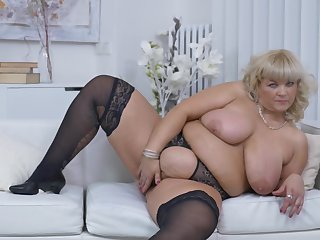 Buxom blonde BBW Renatte takes off her dress and panties at home