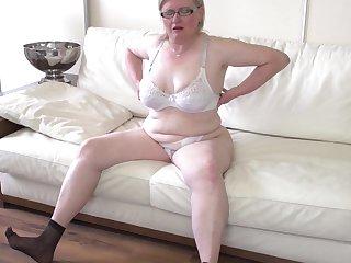 Mature amateur blonde BBW Jaroline K. fingers her asshole