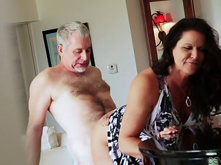 Bootyful and big tittied cougar Leylani Wood goes wild on a hard dick and gets doggy fucked