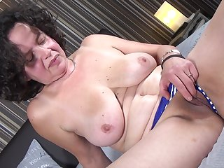 Curly haired buxom mature amateur MILF Tanja K. masturbates