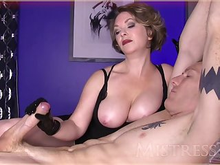 MILF mistress ties her male slave and strokes his thick dick