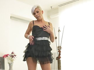 Mature amateur short haired blonde Kathy White strips and masturbates