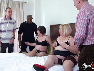 Two horny mature ladies enjoying attention of three handy guys